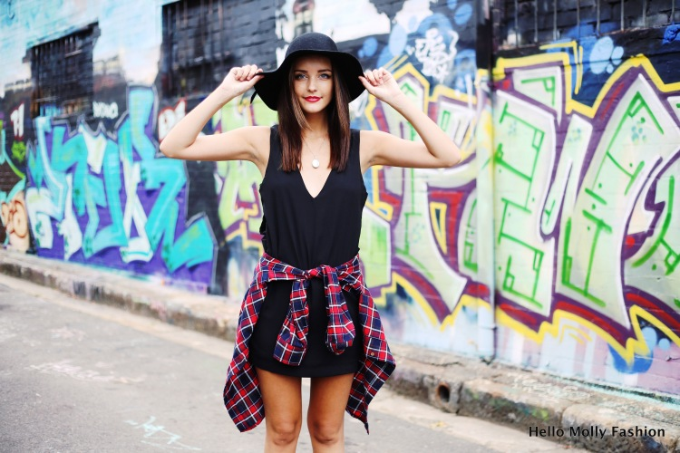 girl in LBD and plaid shirt